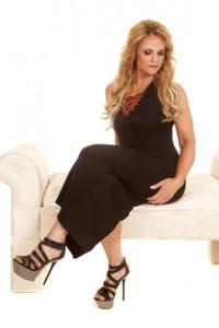 Mature woman black dress sit look down